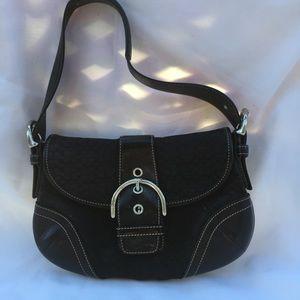 Black flap Coach purse.